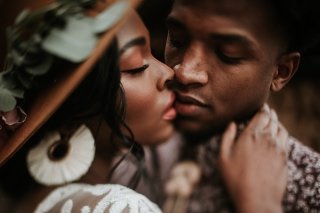 black woman and black man kissing | The Guilty Woman