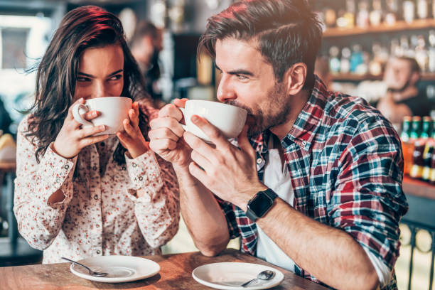 man and woman drinking coffee | The Guilty Woman