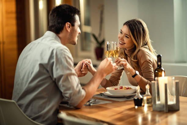 man and woman toasting on a date | The Guilty Woman
