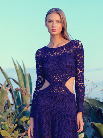 woman wearing blue crochet dress