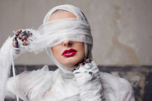 cover photo of a woman dress as a mummy costume