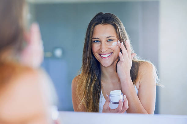 a woman applying night cream | The Guilty Woman