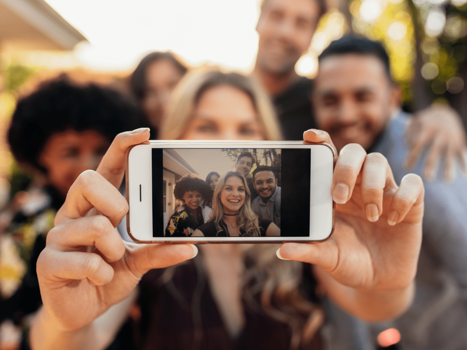 Friends taking a group selfie at party | Lifestyle Details