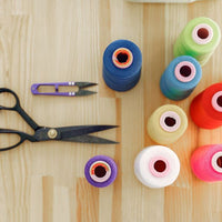Sewing supplies - scissors, thread in different colors