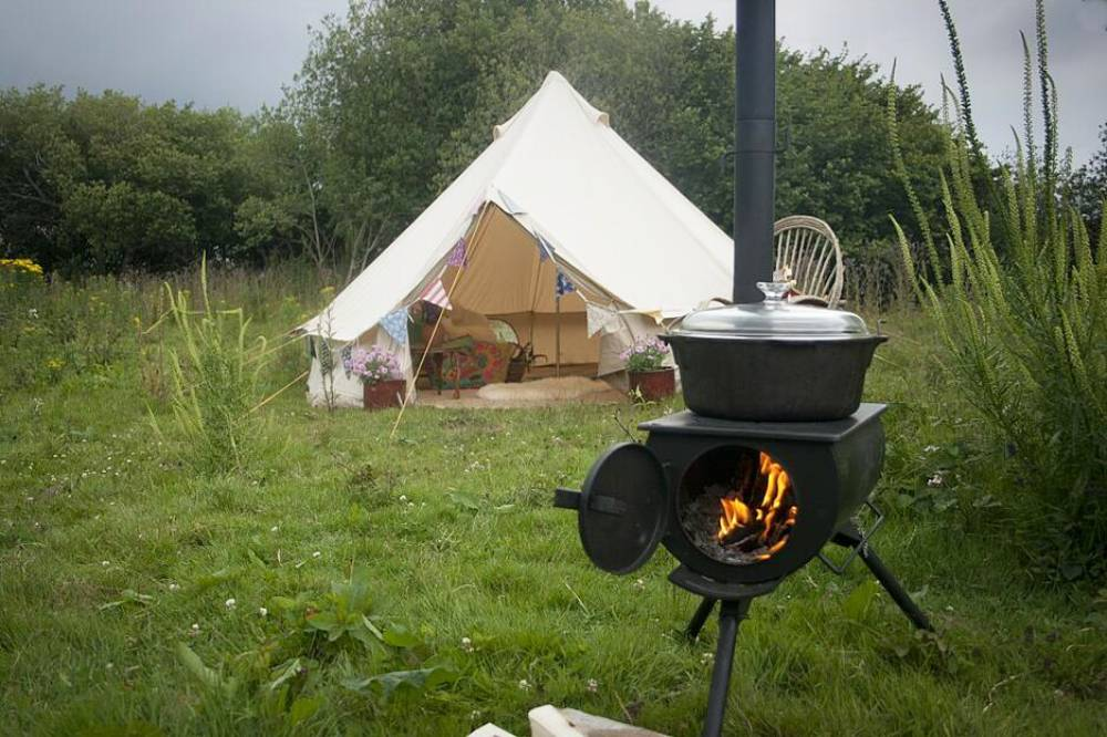Woodburning Frontier Stove outside a bell tent