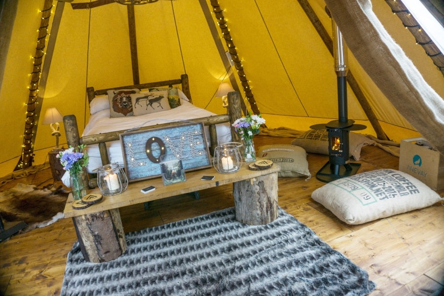 Glamping bell tent with woodburning stove