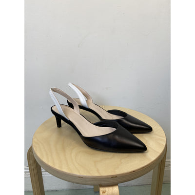 Black & White Slingback Pumps by Flattered