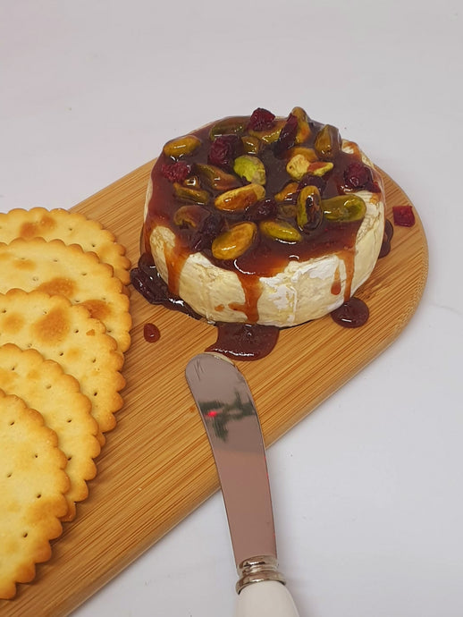 Baked Brie with Manuka With Plum, Pistachio and Cranberry