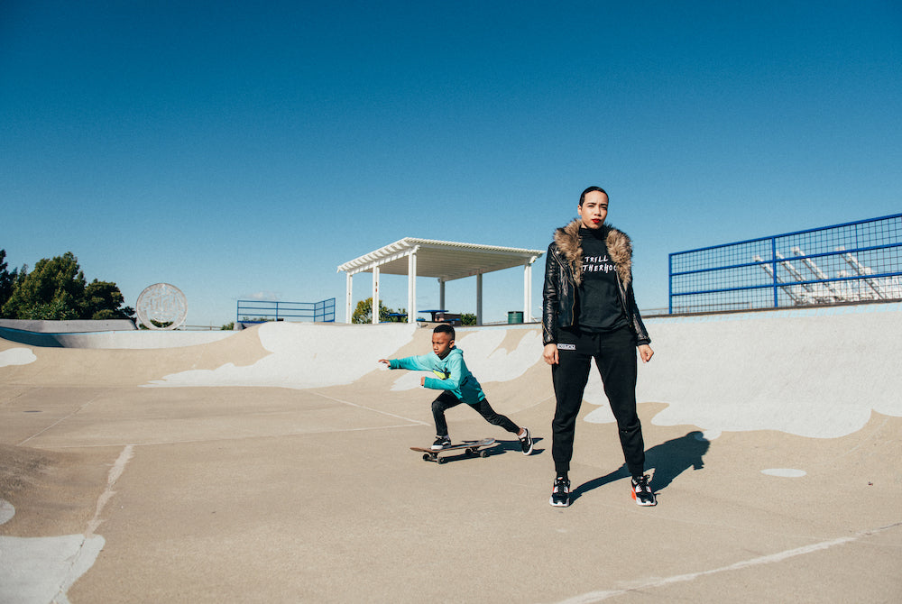 Trill Motherhood. Mama and son in skate park.