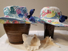 Load image into Gallery viewer, Handmade and hand printed Sunhat, Blue and Rose design, reversible. washable, and packable, handmade by Ouida Touchon, for sale, limited edition.