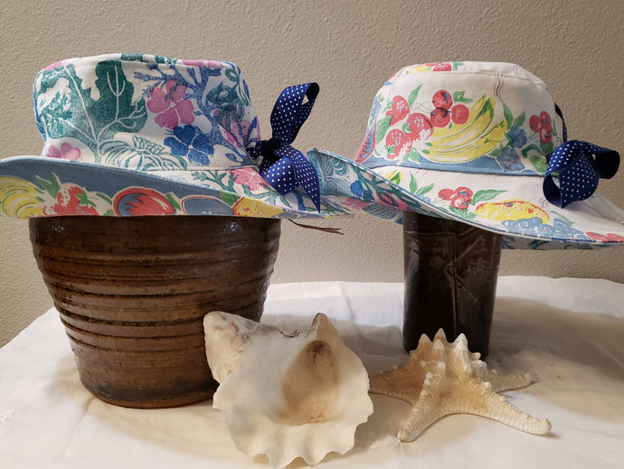 Handmade and hand printed Sunhat, Blue and Rose design, reversible. washable, and packable, handmade by Ouida Touchon, for sale, limited edition.