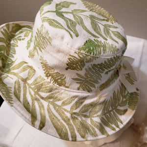 Handmade and hand printed Sunhat, Scattered Ferns, reversible. washable, and packable, handmade by Ouida Touchon, for sale, limited edition.