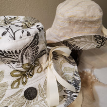 Load image into Gallery viewer, Handmade and hand printed Sunhat, Songbird pattern, reversible. washable, and packable