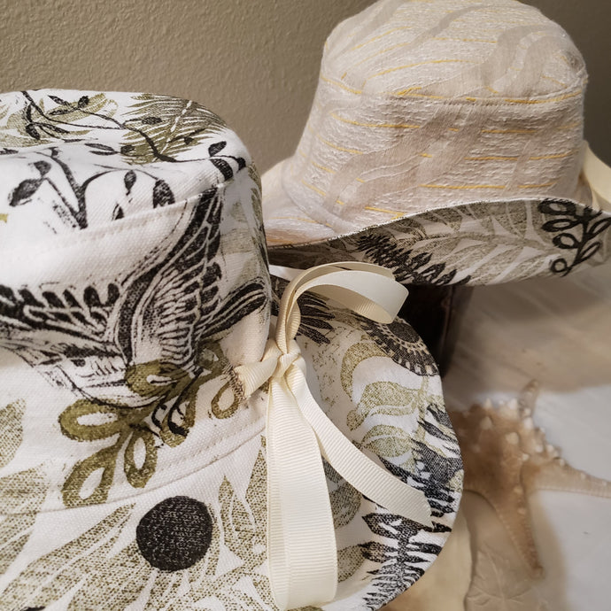 Handmade and hand printed Sunhat, Songbird pattern, reversible. washable, and packable