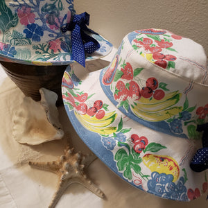Handmade and hand printed Sunhat, Blue and Rose design, reversible. washable, and packable
