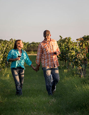 Dan & Jeanie walking in the vineyard at Robert Clay Vineyards in Mason, TX.