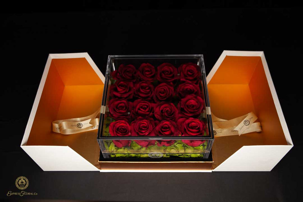 EMPRESS FLORA BIG 16 BURGUNDY RED ROSES IN AN ACRYLIC BOX