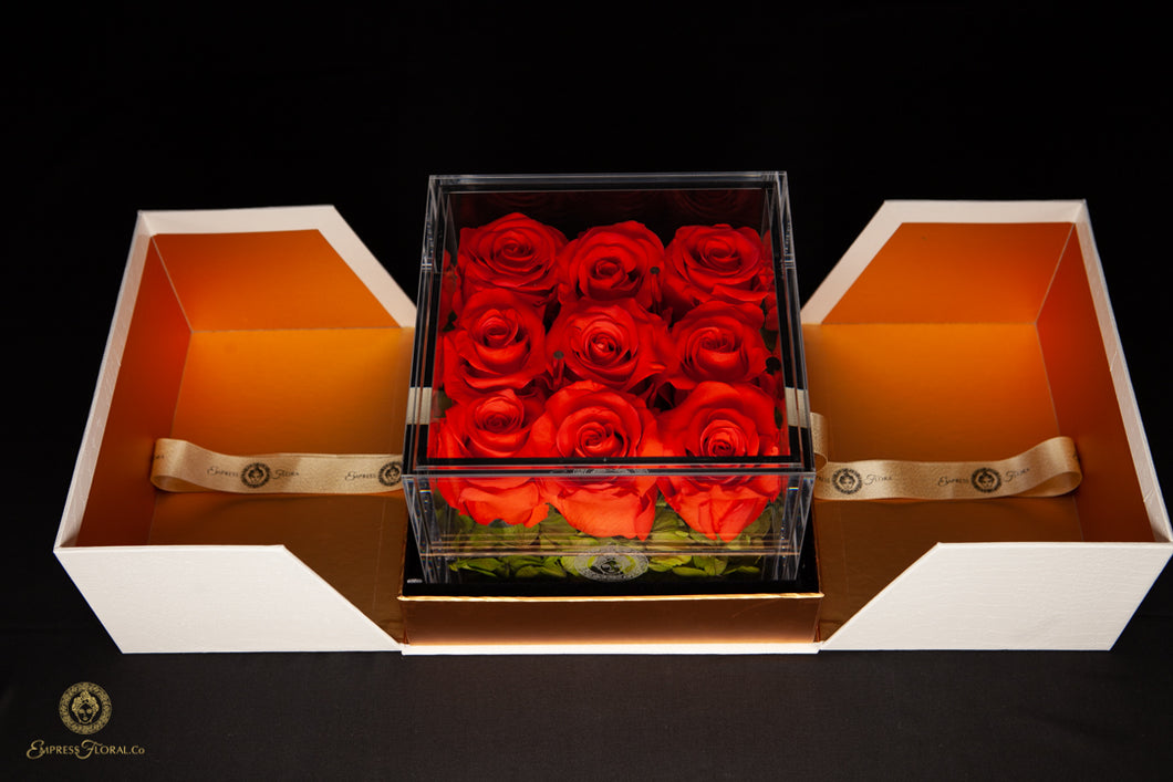 EMPRESS FLORA 9 SET ORANGE ROSES IN A DISPLAY CASE
