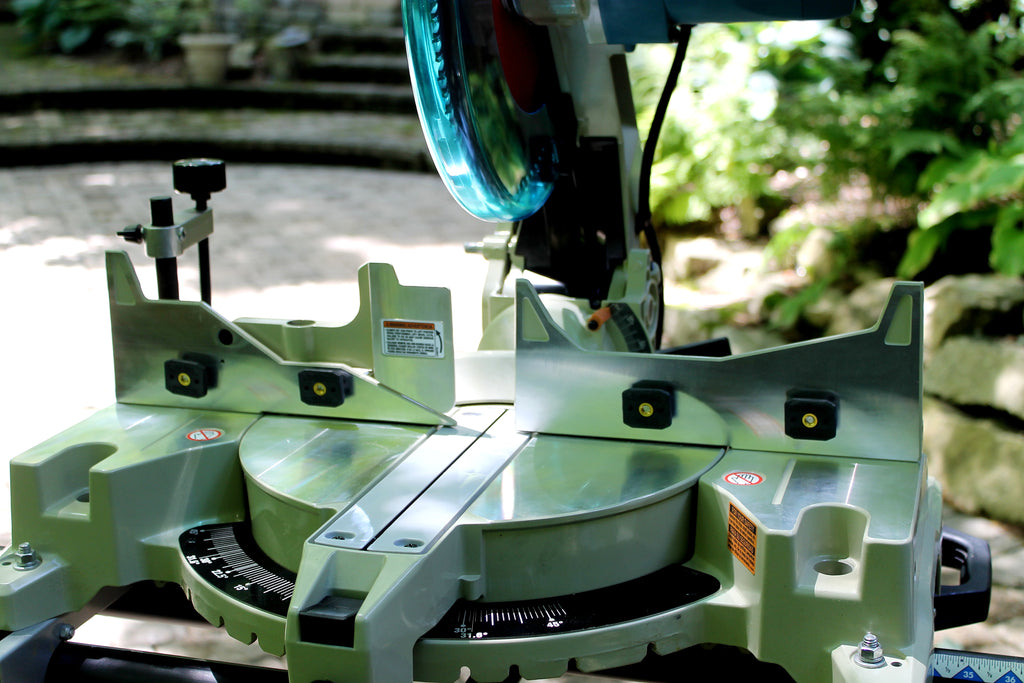 WoodAnchor sliding nuts installed on a compound miter saw fence, ready for mounting an adjustable zero-clearance fence