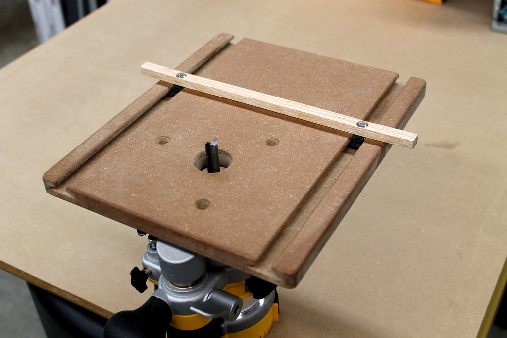 A WoodAnchor router slotting guide