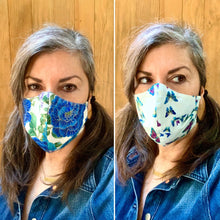Load image into Gallery viewer, Blue Floral on White / Butterflies on White - Reversible PPE Made-to-order Couture Face Mask available In Standard Fit w/ Filter Pocket,  4 layer Sleeker Profile, and Children's w/ Filter Pocket (shown in our REG. FIT, Med. size)