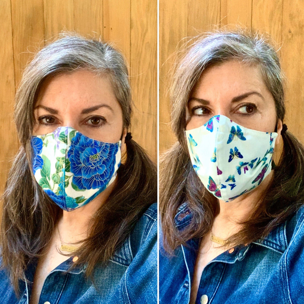 Blue Floral on White / Butterflies on White - Reversible PPE Made-to-order Couture Face Mask available In Standard Fit w/ Filter Pocket,  4 layer Sleeker Profile, and Children's w/ Filter Pocket (shown in our REG. FIT, Med. size)