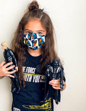 Load image into Gallery viewer, May the Force be with you - Reversible PPE Made-to-order Couture Face Mask available In Standard Fit w/ Filter Pocket,  4 layer Sleeker Profile, and Children's w/ Filter Pocket (shown in our REG. FIT, Med. size)
