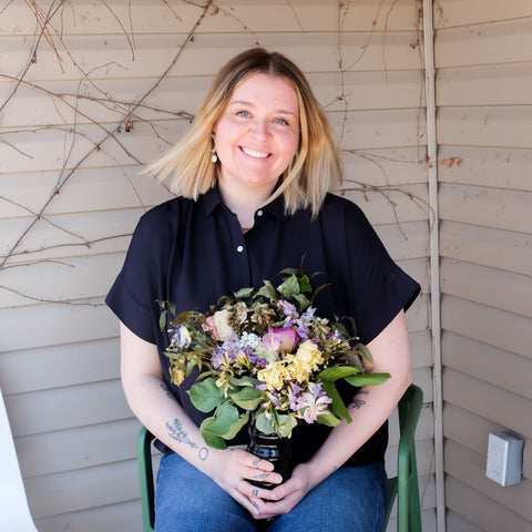 Owner of Stone Tulip Goods, Laura Campbell, holding a bouquet