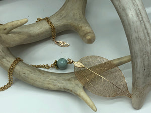 Gold Leaf Necklace with stunning blue stone, on a long gold chain.