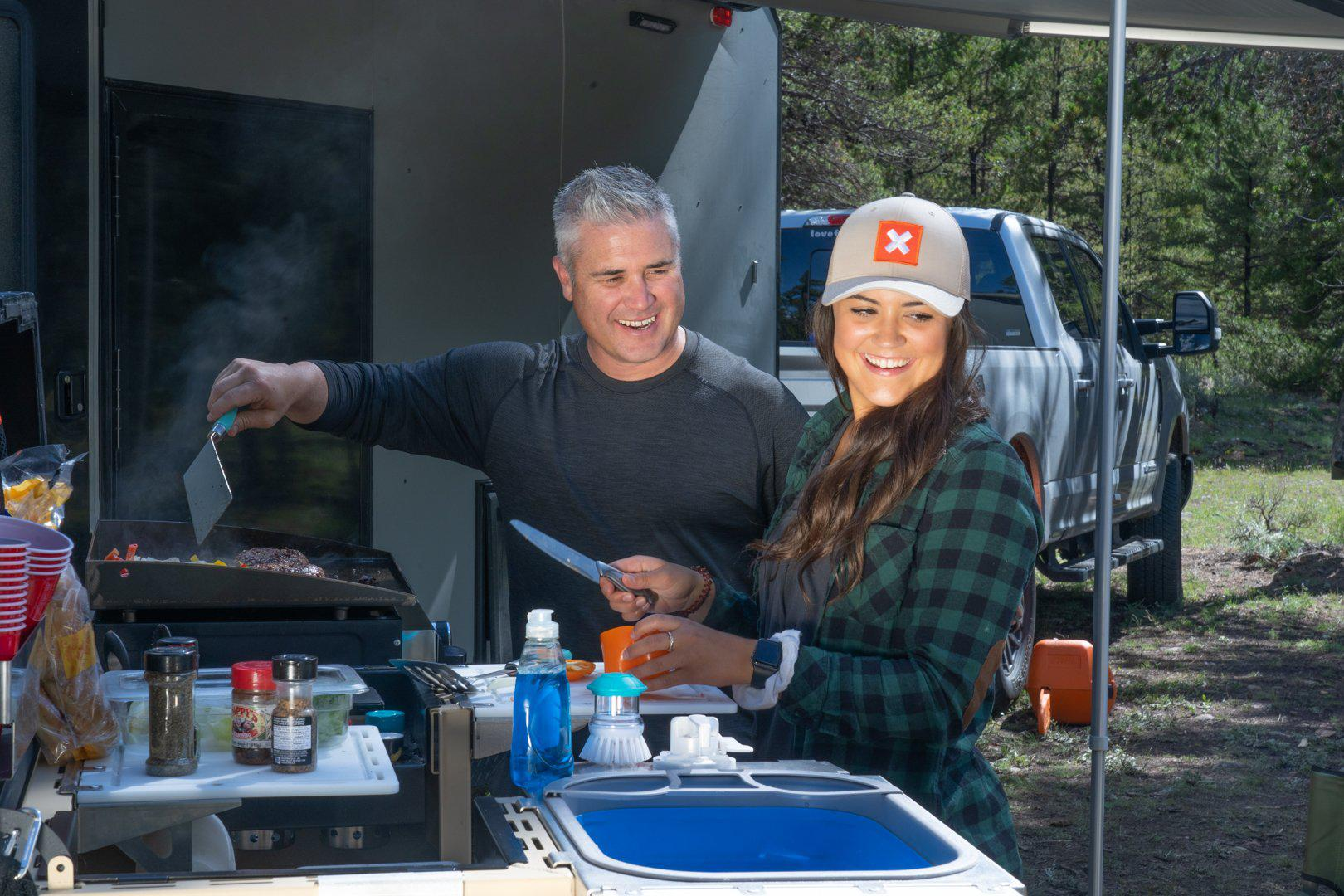 Collapsible Sink pictured with two people using a tailgatengo