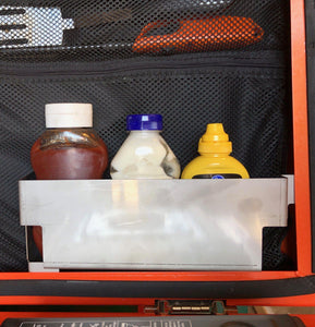 Condiment shelve holding ketchup mayo and mustard