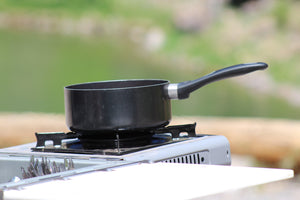 single burner stove with small pot on top