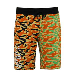 Multi-colored printed shorts featuring an elastic waist with adjustable drawstrings With Strey print in white on the right side of the shorts.