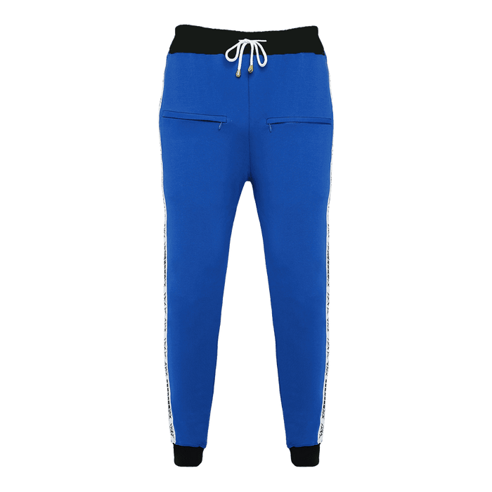 Blue track pant featuring an elastic waist with adjustable drawstrings and front pockets with white strips on the side.