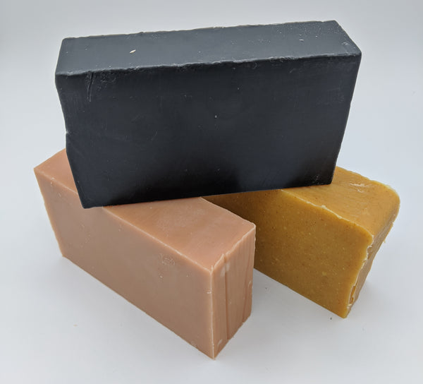 Warrior peppermint and tea tree activated charcoal facial cleansing and body bar, Luscious Lavender french pink clay soap, Eastern Gold lemongrass and turmeric soap