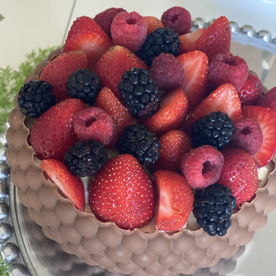 Bowl of chocolate with berries