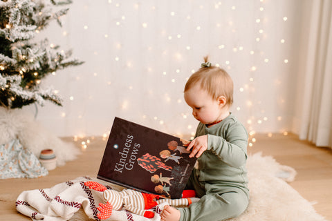 Toddler reading Kindness Grows book