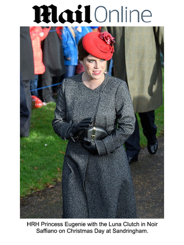 Princess Eugenie on Christmas Day with unique designer clutch bag by Stacy Chan