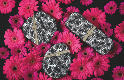 Monochrome Clutch Bags on Pink Flowers