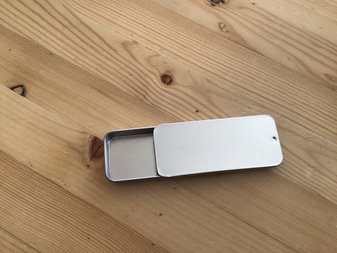 Metal slide container