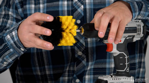 Insert a yellow original into the chuck of a Parter Cable cordless drill
