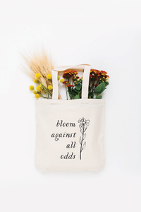 Bloom Against All Odds Tote Bag