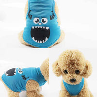 Blue pets fashion cartoon monster vest shirt on a cute fluffy pet dog