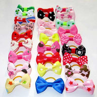 Stylish pets' hair bows for dog and cat pets in variety of print designs