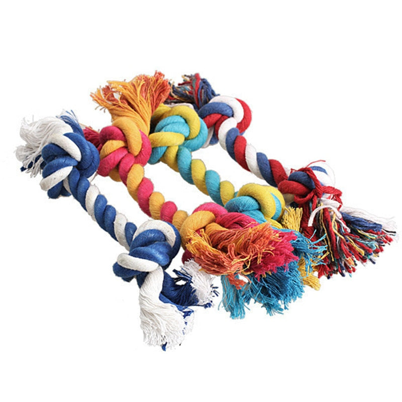 Collection of playful dog bone rope toys in various colors