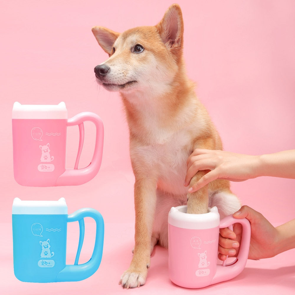 Cute pet dog getting his paws cleaned by his owner with a pet paw cleaner product shop