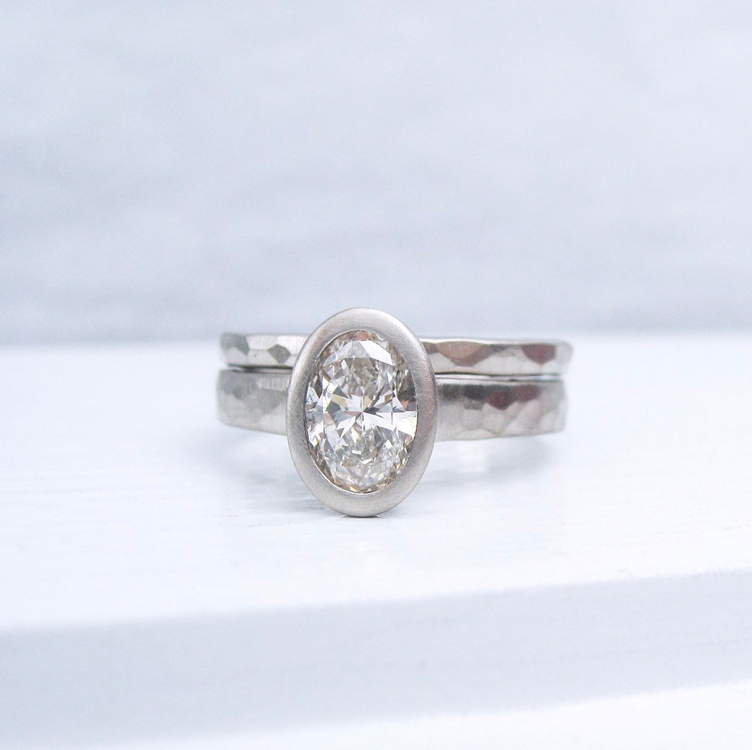 One carat oval diamond engagement ring and hammered wedding band