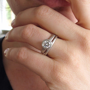 Bezel set solitaire engagement ring semi-mount with narrow hammered wedding band