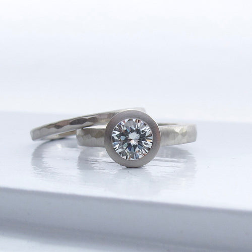 Bezel set solitaire lab grown diamond engagement ring with narrow hammered wedding band