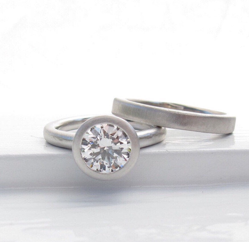 One and a half carat diamond engagement solitaire, platinum setting, GIA certified diamond